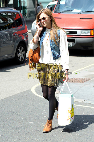 FEARNE COTTON.Leaving work, London, England..May 19th, 2010.full length black tights gold dress pleats pleated brown brogues shoe white shirt  top jean denim sleeveless vest top brown fringed tassels bag purse sunglasses shades shopping.CAP/DYL.©Dylan/Capital Pictures.