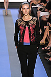 Helen walks runway in a carbon black Chantilly lace crew neck knit cardigan, magenta Chantilly lace corset, and carbon black stretch wool with lace racer stripe, by Monique Lhuillier, from the Monique Lhuillier Spring 2012 collection fashion show, during Mercedes-Benz Fashion Week Spring 2012.