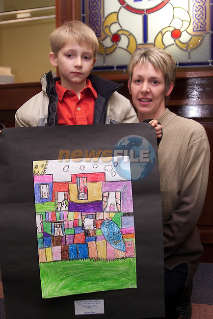 Andrew Hand, Dromin, winner of the 7 and under section of the credit union poster competition in Dunleer pictured with Sandra O'Brien of theboard of directors.