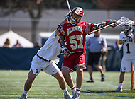 Washington, DC - March 31, 2018: Denver Pioneers Ethan Walker (57) gets hit in the helmet during game between Denver and Georgetown at  Cooper Field in Washington, DC.   (Photo by Elliott Brown/Media Images International)
