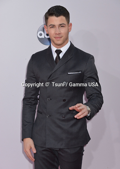 Nick Jonas 145 at the 2014 American Music Awards arrival at the Nokia Theatre on Nov. 23, 2014, in Los Angeles.