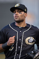Charlotte Knights second baseman Micah Johnson (3) jogs off the field between innings of the game against the Columbus Clippers at BB&T BallPark on May 27, 2015 in Charlotte, North Carolina.  The Clippers defeated the Knights 9-3.  (Brian Westerholt/Four Seam Images)