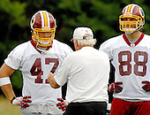 Ashburn, VA - June 16, 2007 -- Washington Redskin tight ends coach Rennie Simmons shows some technique to tight end  Chris Cooley (47) and Tyler Ecker (88) as they participate in the second day of the second and final mini-camp at Redskin Park in Ashburn, Virginia on Saturday, June 16, 2007..Credit: Ron Sachs / CNP