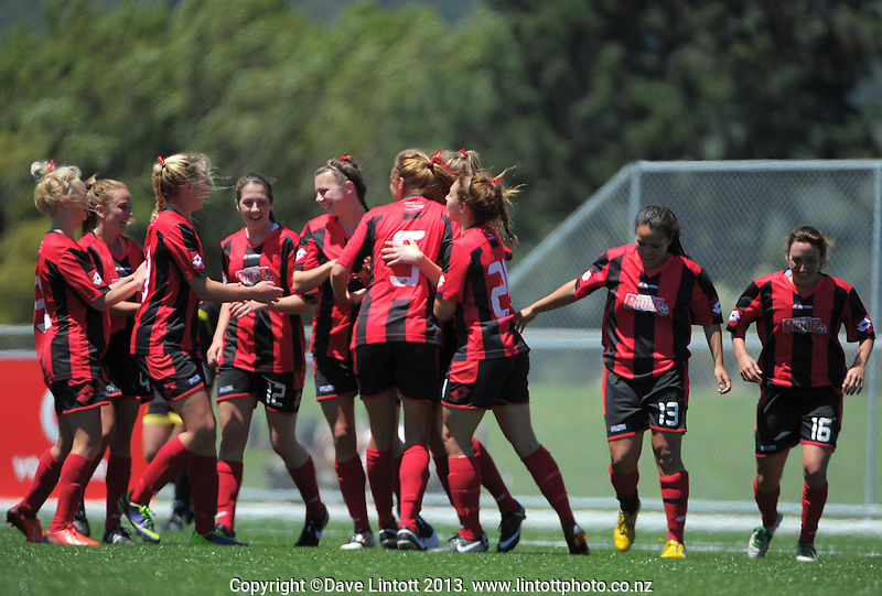 The Mainland team celebrate their second goal during the ASB Women's League football semifinal match between Capital (black with yellow trim) and Mainland (red and black) at Petone Memorial Park, Wellington, New Zealand on Sunday, 1 December 2013. Photo: Dave Lintott / lintottphoto.co.nz