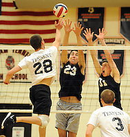 William Tennent's Tom Del Conte #28 volleys past Council Rock North's Jason Yakima #23 and Josh Hinton #31 during a volleyball match at William Tennent High School Monday April 20, 2015 in Warminster, Pennsylvania. (Photo by William Thomas Cain/Cain Images)