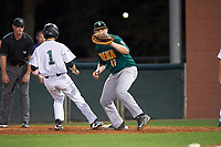 Siena Saints first baseman Joe Drpich (47) waits for a pickoff attempt throw as Jacob Koos (1) gets back to the bag with umpire Ray Parrish looking on during a game against the Stetson Hatters on February 23, 2016 at Melching Field at Conrad Park in DeLand, Florida.  Stetson defeated Siena 5-3.  (Mike Janes/Four Seam Images)