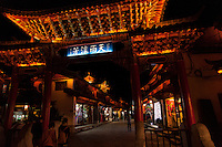 The outdoor lighting on streets of Lijiang display the intricate craftsmanship of the architecture.