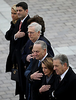 Congressional leaders (L-R) Speaker of the House Paul Ryan (R-WI), Senate Majority Leader Mitch McConnell (R-KY), Senate Minority Leader Chuck Schumer (D-NY) and House Minority Leader Nancy Pelosi (D-CA) watch as a U.S. military honor guard team carries the flag draped casket of former U.S. President George H. W. Bush from the U.S. Capitol December 5, 2018 in Washington, DC. A funeral service will be held today for former U.S. President Bush at the Washington National Cathedral. President Bush will be buried at his final resting place at the George H.W. Bush Presidential Library at Texas A&amp;M University in College Station, Texas. A WWII combat veteran, Bush served as a member of Congress from Texas, ambassador to the United Nations, director of the CIA, vice president and 41st president of the United States. <br /> CAP/MPI/RS<br /> &copy;RS/MPI/Capital Pictures