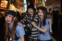 Japanese women, dressed as police women and prisoners students during the Halloween celebrations in Shibuya, Tokyo, Japan. Saturday October 29th 2016 Halloween celebration in Japan have grown massively in the last few years. To ensure the safety of the crowds in Shibuya this year, the police closed several roads leading to the famous Hachiko Square, allowing costumed revellers to spread over a larger area.