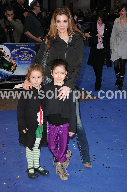 **ALL ROUND PICTURES FROM SOLARPIX.COM**.**WORLDWIDE SYNDICATION RIGHTS**.the UK premiere of Nanny McPhee And The Big Bang, .Odeon West End, Leicester Square, London, UK. 24 March 2010..This pic: Dr Linda Papadopoulos and children..JOB REF: 10974 MSR    DATE: 24_03_2010.**MUST CREDIT SOLARPIX.COM OR DOUBLE FEE WILL BE CHARGED**.**MUST NOTIFY SOLARPIX OF ONLINE USAGE**.**CALL US ON: +34 952 811 768 or LOW RATE FROM UK 0844 617 7637**