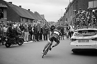 Fabian Cancellara (CHE/TrekFactoryRacing) getting back to the peloton maneuvering through the team cars <br /> <br /> Ronde van Vlaanderen 2014