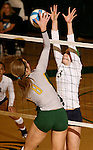 SPEARFISH, SD - NOVEMBER 2, 2013:  Holly Hamlin #8 of Black Hills State attempts a kill shot as Sarah Pekarek #3 of Colorado Mines tries to block during their game Saturday at the Donaldo E. Young Center in Spearfish, S.D.  (Photo by Dick Carlson/Inertia)