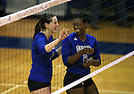 Marymount's Erin Allison and Morgan McAlpin celebrate a point in a college volleyball game against St. Mary's in Lexington Park, MD, on Wednesday, Oct. 29, 2014. Marymount won 3-2 to go 24-9 on the season.<br /> Photo by Cathleen Allison