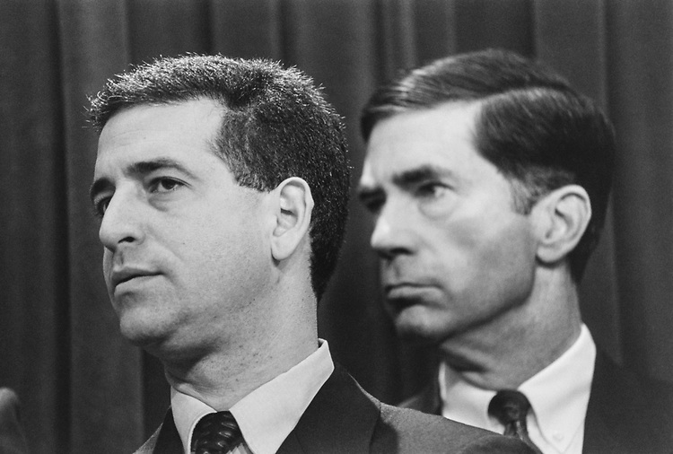 Sen. Russ Feingold, D-Wis., and Sen. Chuck Robb, D-Va., listen to Senators speak at a press conference on budget cuts, on Nov. 10, 1993. (Photo by Maureen Keating/CQ Roll Call via Getty Images)