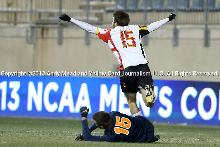 13 December 2013: Maryland's Patrick Mullins (above) celebrates getting past Virginia's Kevin McBride (below) and scoring his second goal of the game. The University of Maryland Terripans played the University of Virginia Cavaliers at PPL Park in Chester, Pennsylvania in a 2013 NCAA Division I Men's College Cup semifinal match. Maryland won the game 2-1.