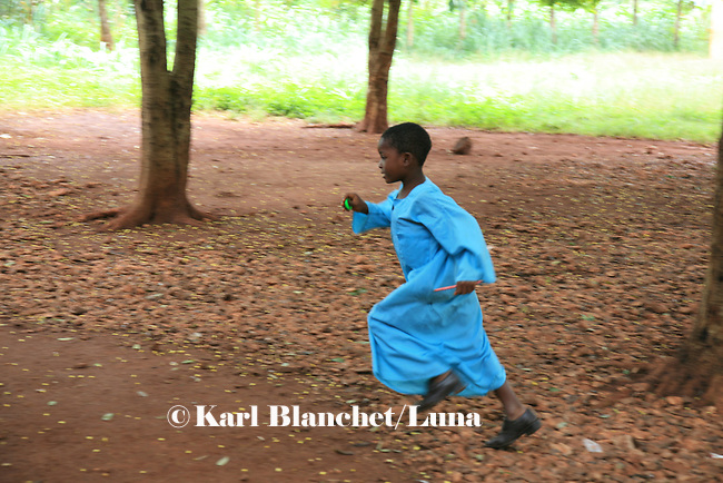 A pupil running in the yard of the Islamic school in Sunyani, Ghana. In Ghana, coranic schools were transformed into islamic schools. Pupils learn the mainstream curriculum and have additional courses in arabic and islam.