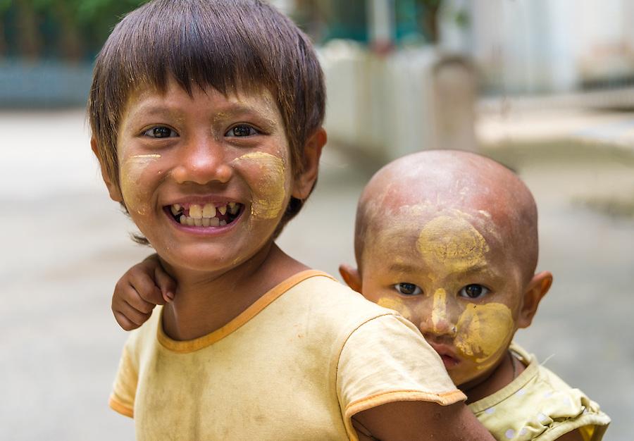 MANDALAY, MYANMAR - CIRCA DECEMBER 2013: Happy Burmese children playing in the streets of Amarpura in Myanmar