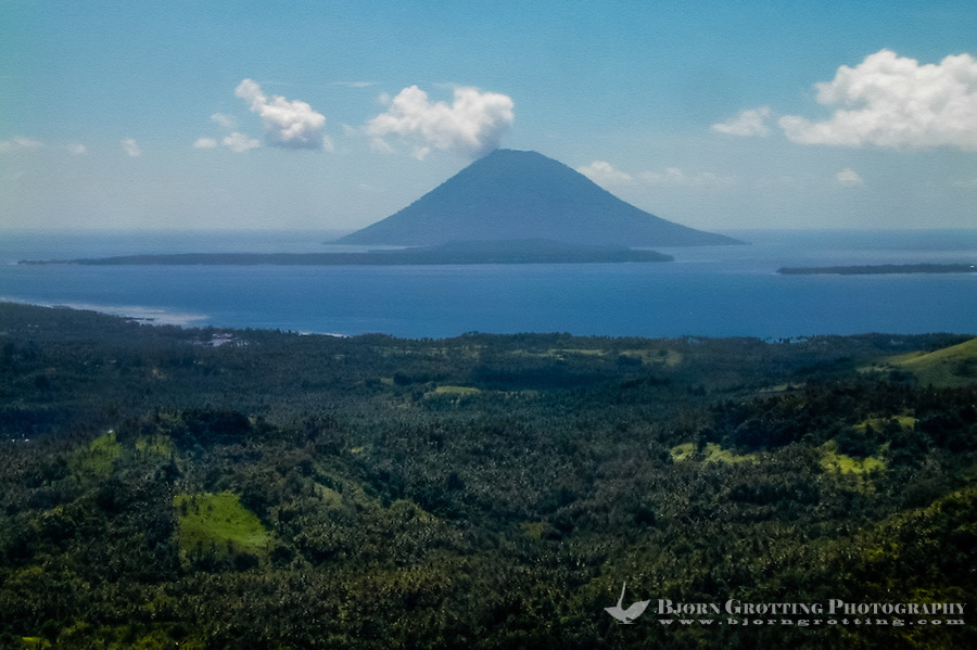 Indonesia, Sulawesi, Bunaken. Bunaken and Manado Tua seen from airplane, close to Manado's airport.