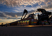 Oct 29, 2016; Las Vegas, NV, USA; The sun sets behind the dragster of NHRA top fuel driver Tony Schumacher as the car is towed back to the pits during qualifying for the Toyota Nationals at The Strip at Las Vegas Motor Speedway. Mandatory Credit: Mark J. Rebilas-USA TODAY Sports
