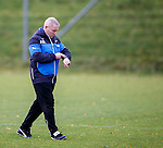 Ally McCoist walks out for training this morning and checks the time
