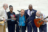 Peter Yarrow and Paul Stookey perform as Trayvon Martin's parents and the parent of a parent of a victim of the Newtown Massacre look on at the Let Freedom Ring ceremony on the steps of the Lincoln Memorial to commemorate the 50th Anniversary of the March on Washington for Jobs and Freedom<br /> Credit: Ron Sachs / CNP