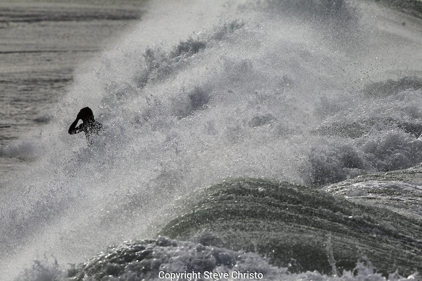 Surfing..A big swell brought with it some big surf as local surfers enjoy the conditions at Manly Beach.  Sydney, Australia, Wednesday, June, 6th, 2012.(Photo: Steve Christo)