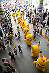 "Visitors take pictures of the Pikachus marching on the street during the parade at the ""1000 Pikachu Outbreak! at Yokohama Minatomirai"" on August 09, 2014. 1000 Pikachu performed at different areas of Minatomirai in Yokohama during the summer vacation event from August 9 to 17.  (Photo by Rodrigo Reyes Marin/AFLO)"