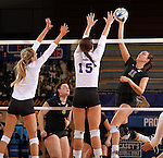 BROOKINGS, SD - NOVEMBER 9:  Wagner Larson #11 from South Dakota State University tries for a kill past Mallory Gibson #12 and Jordan Jackson #15 from Western Illinois in the second game of their match Saturday at Frost Arena. (Photo by Dave Eggen/Inertia)