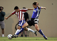 10 September 2005: Kelly Gray of the Earthquakes tries to tackle the ball away from Antonio Martinez of the CD Chivas USA during the first half of the game at Spartan Stadium in San Jose, California.    San Jose Earthquakes tied CD Chivas USA, 0-0 at halftime.