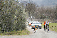 elite women's road world champion Amalie Dideriksen (DEN/Boels-Dolmans) avoiding a loose dog during the 2017 Strade Bianche recon (the day before the race)