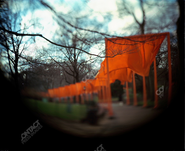 """""""The Gates"""" Artists Christo and Jeanne-Claude, his wife, installed 7,500 gates along 23 miles of foot paths in Central Park. The installation will be open from February 12 to February 27, 2005. New York City, New York,  February, 2005."""
