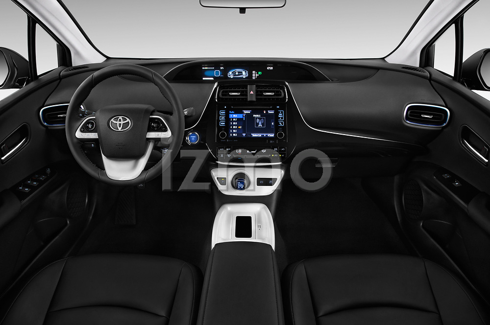 Stock photo of straight dashboard view of 2016 Toyota Prius Three Touring 5 Door Hatchback