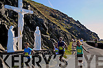 Brenda Duffy from Lispole and Dunshaughlin waving to camera as she rounded Slea Head during the Dingle Marathon on Saturday