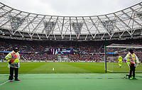 Stewards who surround the pitch stand for as Marko Arnautovic of West Ham United celebrates his 2nd goal during the EPL - Premier League match between West Ham United and Southampton at the Olympic Park, London, England on 31 March 2018. Photo by Andy Rowland.