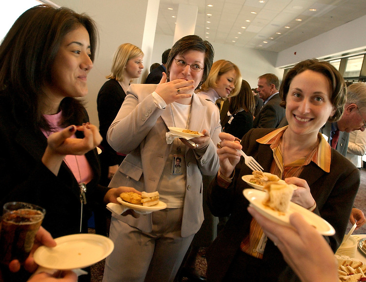 Senate staffers from left, Aneesa Din, Carolyn Chuhta, and Dvora Lovinger, enjoy peanut-themed cuisine at an event to celebrate National Peanut Butter Day in Hart 902.  The event was held by The Southern Peanut Farmers to coincide with the fact that March is National Peanut Month.