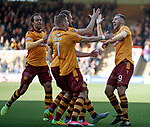 Louis Moult celebrates with goalscorer Peter Hartley after he knocked in Moult's free-kick