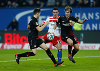Hamburg, Germany, 1. Football  BL,  match day 23,<br />Hamburger SV  vs Bayer Leverkusen 1 - 2 17 . 02 .2018  Volksparkstadium  in Hamburg <br />Retros PANAGIOTIS (LEV) , Filip KOSTIC (HSV) and Tin JEDVAJ (LEV) v.n.-<br /> <br /> *** Local Caption *** © pixathlon<br /> Contact: +49-40-22 63 02 60 , info@pixathlon.de