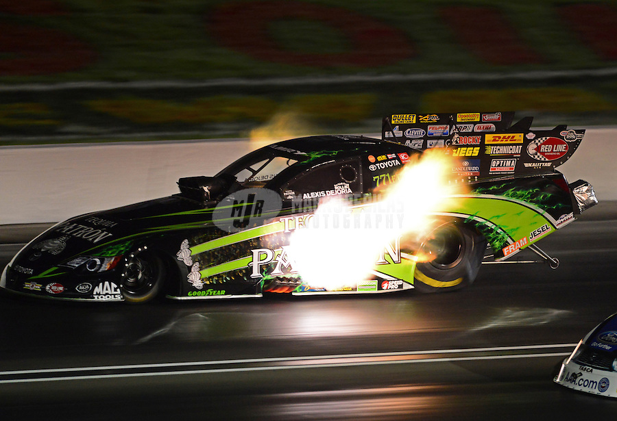 Sept. 1, 2012; Claremont, IN, USA: NHRA funny car driver Alexis DeJoria during qualifying for the US Nationals at Lucas Oil Raceway. Mandatory Credit: Mark J. Rebilas-