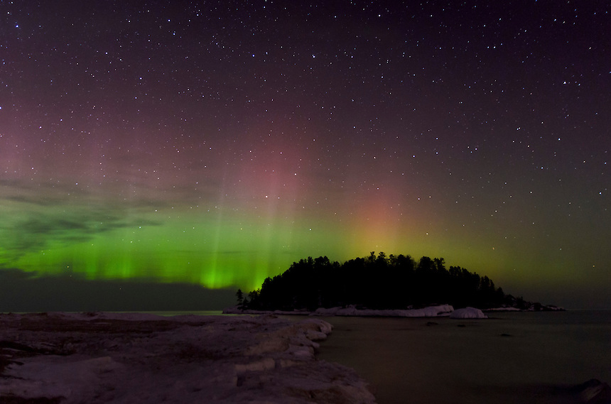A beautiful Northern Lights display showcasing itself over Lake Superior at Little Presque Isle on a March evening. Marquette, MI.