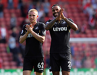 (L-R) Oliver McBurnie and Kyle Bartley of Swansea City thank away supporters at the end of the game during the Premier League match between Southampton and Swansea City at the St Mary's Stadium, Southampton, England, UK. Saturday 12 August 2017