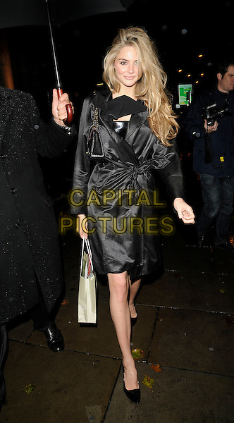 TAMSIN EGERTON.The Vogue Fantastic Fashion Fantasy Party, 1 Marylebone, Marylebone Road, London, England..November 3rd, 2008.full length black coat jacket mac tamzin goody bag .CAP/CAN.©Can Nguyen/Capital Pictures.