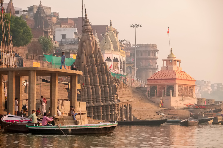 The spire of a sunken temple tilts in the waters of the Ganges at Varanasi.