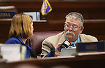 Nevada Senate Republicans Becky Harris and Pete Goicoechea work on the Senate floor during a special session at the Nevada Legislature in Carson City, Nev. on Tuesday, Oct. 11, 2016. <br /> Photo by Cathleen Allison