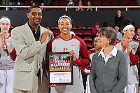 STANFORD, CA - December 22, 2015: Stanford defeats CSU Bakersfield 83-41 at Maples Pavilion. Erica McCall is recognized for her summer with USA Basketball by her father, CSU Bakersfield head coach, Greg McCall, and Tara VanDerveer.