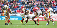 Huddersfield Giants' Shannon Wakeman is tackled by Wigan Warriors' Ben Flower, Joel Tomkins and George Williams <br /> <br /> Photographer Stephen White/CameraSport<br /> <br /> Betfred Super League Round 5 - Wigan Warriors v Huddersfield Giants - Sunday 19th March 2017 - DW Stadium - Wigan<br /> <br /> World Copyright &copy; 2017 CameraSport. All rights reserved. 43 Linden Ave. Countesthorpe. Leicester. England. LE8 5PG - Tel: +44 (0) 116 277 4147 - admin@camerasport.com - www.camerasport.com