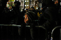 A child attends a rally outside of City Hall against police violence as another group attend a rally in support of the New York Police Department (NYPD)  in New York December 19,2014 . Kena Betancur/VIEWpress