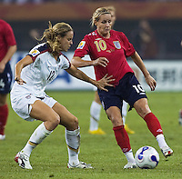 USA midfielder (12) Leslie Osborne tries to take the ball away from England midfielder (10) Kelly Smith. The United States (USA) defeated England (ENG) 3-0 during a quarter-final match of the FIFA Women's World Cup China 2007 at Tianjin Olympics Center Stadium in Tianjin, China, on September 22, 2007.