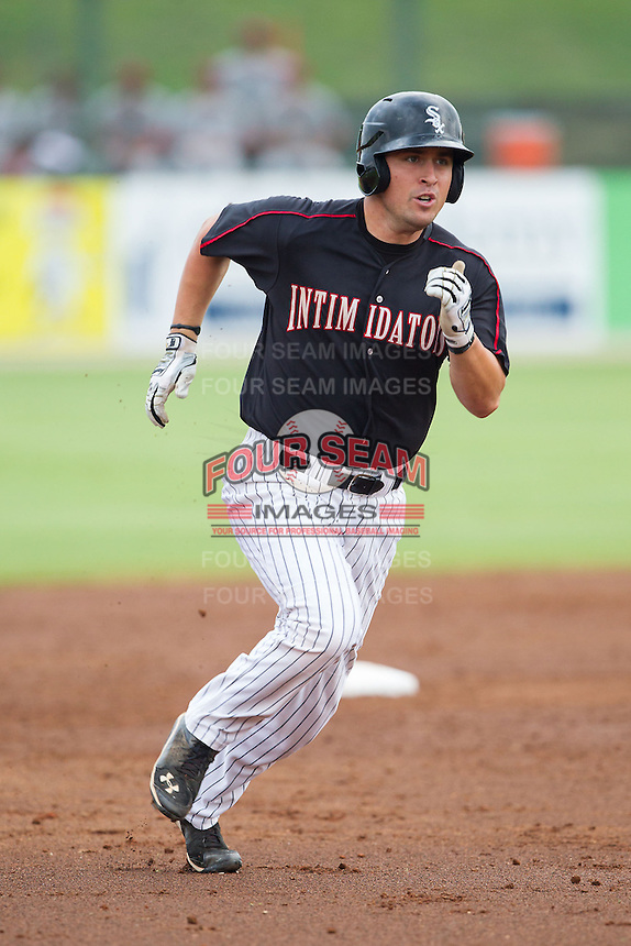 Nolan Early (9) of the Kannapolis Intimidators hustles towards third base against the Lakewood BlueClaws at CMC-NorthEast Stadium on July 20, 2014 in Kannapolis, North Carolina.  The Intimidators defeated the BlueClaws 7-6. (Brian Westerholt/Four Seam Images)
