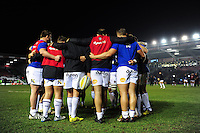 The Bath Rugby forwards huddle together during the pre-match warm-up. Aviva Premiership match, between Harlequins and Bath Rugby on March 11, 2016 at the Twickenham Stoop in London, England. Photo by: Patrick Khachfe / Onside Images
