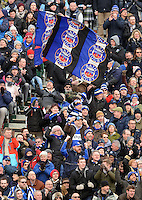 A Bath supporter in the crowd waves a giant flag. European Rugby Champions Cup match, between Bath Rugby and Glasgow Warriors on January 25, 2015 at the Recreation Ground in Bath, England. Photo by: Clare Green for Onside Images